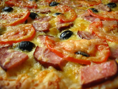 The image of tasty pizza with an appetizing stuffing photo