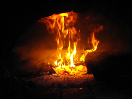 furnace: Fire wood brighly burning in the furnace Stock Photo