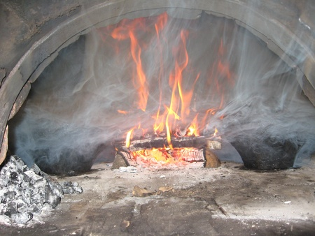 Fire wood burning in the furnace photo