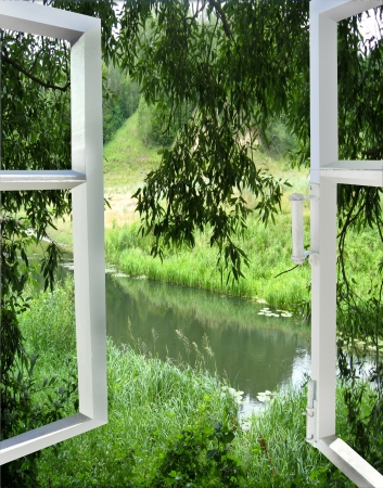 the image of open window overlooking the river photo