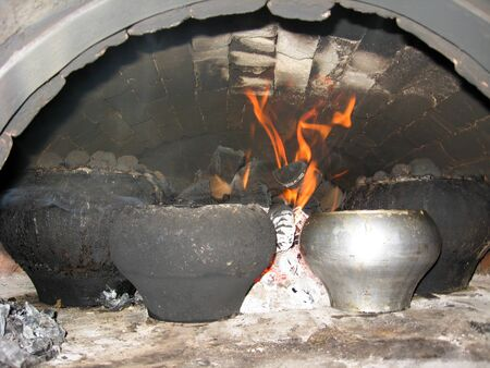 coals: the food cooking in the pig-iron