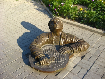 The image of monument to the sanitary technician on road photo
