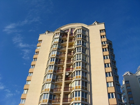 multi-storey modern house on the blue sky background