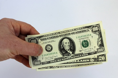 image of hand holding US dollars isolated on a white background photo
