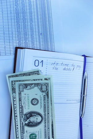 table with numerals, calculator, pen and american dollars Stock Photo - 19118399