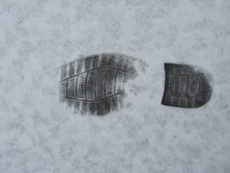 image of trace of shoe on a snow photo