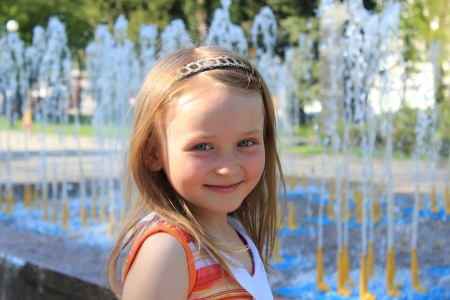 little fashionable girl on the background of fountains photo