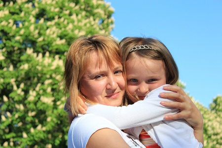 image of mother and daughter are hugging one another Stock Photo - 19758912