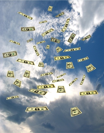 windfall: dollar banknotes flying away in the blue sky