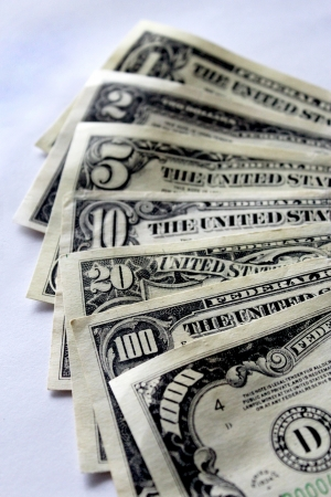 Some dollar banknotes isolated on a white background