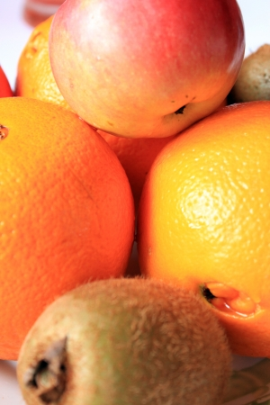 background from the fruit of oranges apple and kiwi photo