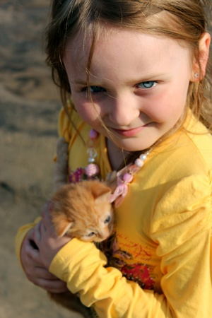 image of little girl with red kitten