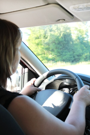 image of young woman driving the car photo