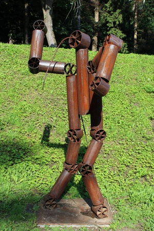 image of figure of abstract robot made from metal shapes photo