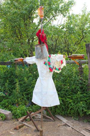 smock: image of motley scarecrow in white docktors smock Stock Photo
