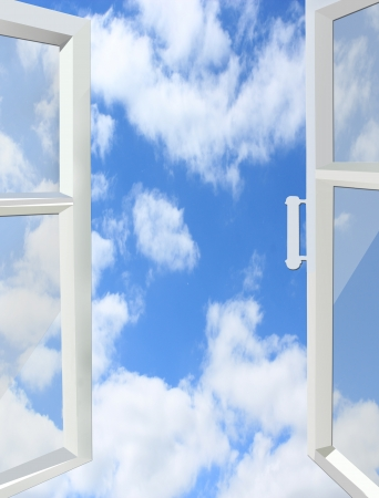 opened window to the heaven with white clouds photo