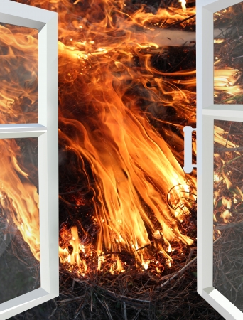 opened window to the fire in the yard Stock Photo - 22039305