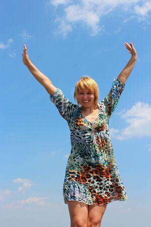 sympathetic: blue-eyed sympathetic girl on the background of blue sky Stock Photo