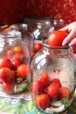 preservation: image of tomatos in jars prepared for preservation