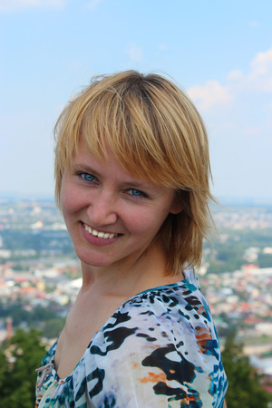 sympathetic: blue-eyed sympathetic girl on the background of view of city Stock Photo