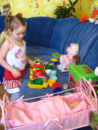 little girl playing with toys in her room photo