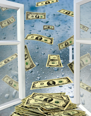 opened window to the surface with drops of water and dollars flying away photo