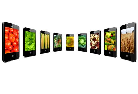 Moderne mobiele telefoons met heldere beelden van verschillende groenten Stockfoto