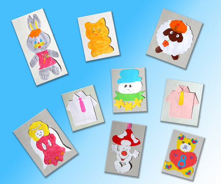 unruffled: different childrens pictures isolated on the light blue  Stock Photo