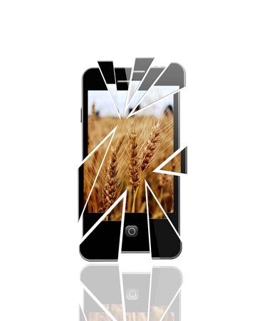 modern broken smartphone with splinters on the white