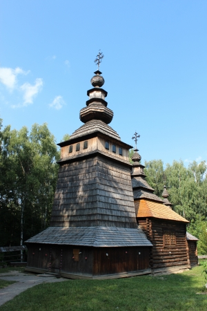 possession: nice wooden and old church in village of Western Ukraine
