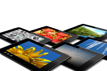 some black tablets with motley pictures isolated on white background photo
