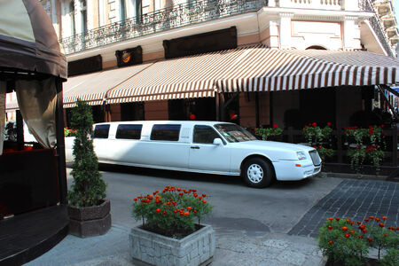 limo: white limousine standing besides caffe in Lvov Editorial