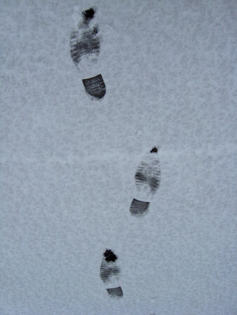 trace of shoe on a snow photo