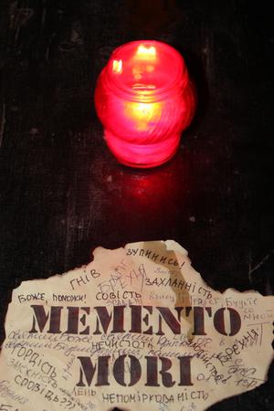 mori: candle and inscription memento mori in church