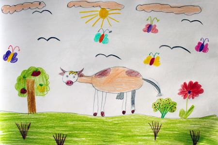 childrens drawing of cow grazing on the pasture with flowers photo