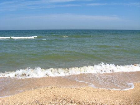 Marine waves on the sand of seacoast