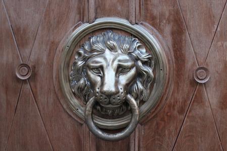 red tanned door-handle in shape of lion