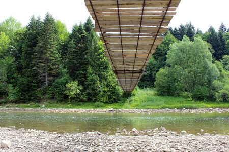 mountainous: nice hanging bridge across speed, mountainous river