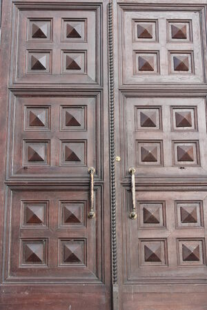 massive church doors with old nice pattern photo
