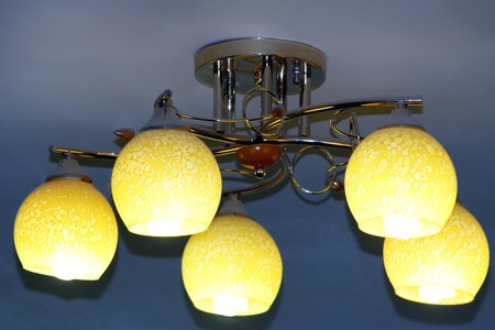 dingy: Beautiful chandelier with five bright plafonds under the ceiling