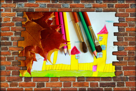 ruined house: broken brick wall and view childrens drawing of house and autumn leaves Stock Photo
