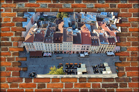 lvov: broken brick wall and beautiful view to the house-tops in Lvov city Stock Photo