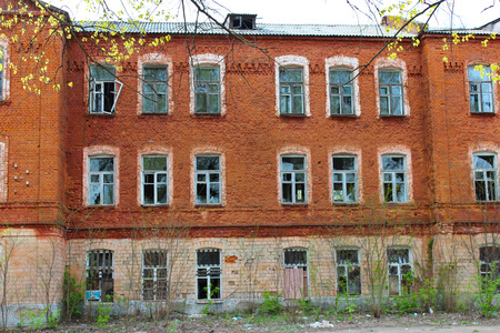 desolate: old desolate and broken building from red brick Stock Photo