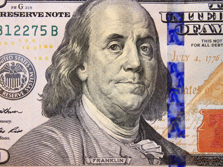 equivalent: hundred dollar bank note with image of president Benjamin Franklin