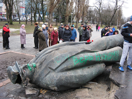 the thrown: thrown big bronze monument to Lenin the leader of world proletariat in Chernihiv Editorial