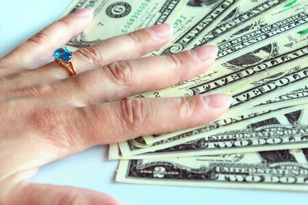 womans hand purchasing the ring with topaz for dollars photo