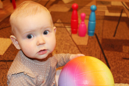 perplexity: little baby with a ball and skittles in perplexity Stock Photo