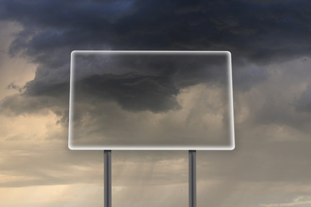 empty and transparent billboard in thunder-storm with dark clouds