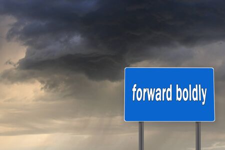 foretaste: Billboard with inscription Forward boldly on the background of dark stormy sky