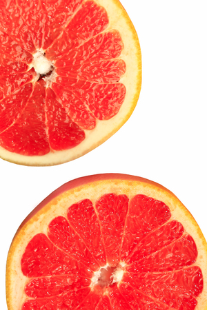 two pieces: two pieces of cut grapefruit isolated on the white